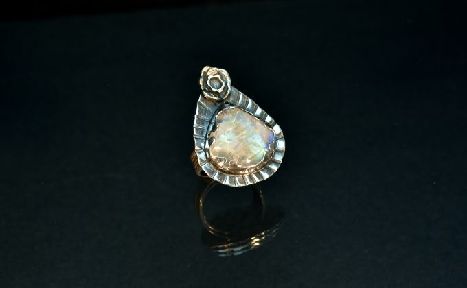 Rainbow moonstone set in sterling silver on a triple band sterling silver ring shank. Size 7.5  $195.00  ring DSC_0407